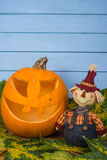 Scarecrow and natural Halloween pumpkin Royalty Free Stock Images