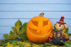 Scarecrow and natural Halloween pumpkin Stock Images