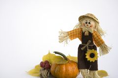 SCARECROW WITH  PUMPKIN. A happy scarecrow with pumpkin on white background Stock Photos