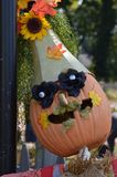 Scarecrow with pumpkin face Royalty Free Stock Photo