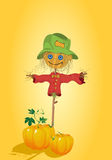 Scarecrow with pumpkins Royalty Free Stock Photos