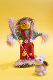 Scarecrow and rabbit. A funny colorful scarecrow with the rabbit Stock Photography