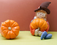 Scarecrow Rag Doll Holding A Pumpkin Stock Image