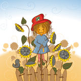 Scarecrow's girlfriend with sunflowers Royalty Free Stock Photography