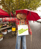 Scarecrow showing direction to farmers market Stock Photos