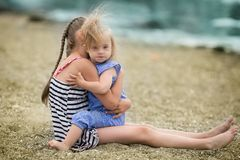 Scarecrow sister lovingly embraces his sister with Down syndrome Stock Image