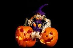 Scarecrow sitting on  Pumpkins Stock Photo