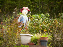Scarecrow. Smiling scarecrow in private garden Stock Image