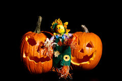 Scarecrow standing with Pumpkins Stock Image