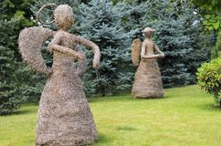 Scarecrow of straw in the form of an angel. Scarecrow of straw as an angel in the garden Royalty Free Stock Photo