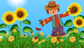 Scarecrow in the sunflower field. Illustration Royalty Free Stock Photography