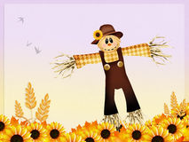 Scarecrow and sunflowers Stock Image