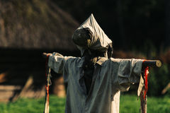Scarecrow and traditional hut Stock Images
