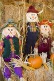 Scarecrow trio. Trio of scarecrows in autumn setting Stock Photo
