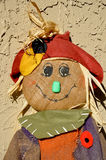 Scarecrow wearing a poppy. Stock Image