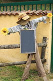 Scarecrow with whiteboard Royalty Free Stock Photos