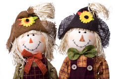 Scarecrows. Cute boy and girl scarecrows Royalty Free Stock Images
