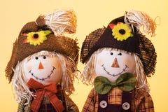 Scarecrows. Cute boy and girl scarecrows Stock Photo