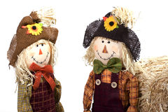 Scarecrows. Cute boy and girl scarecrows with bales of hay Stock Photos