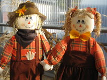 Scarecrows. A pair of colorful scarecrows have lots of color and big smiles to brighten your day Stock Image