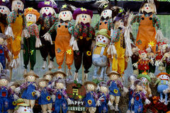 Scarecrows and flowers. Colored bright autumn scarecrows to decorate gardens. pumpkins and straw. Happy harvest Stock Image