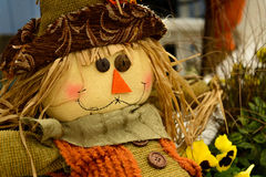 Scarecrows with flowers and hay Stock Photography