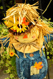 Scarecrows with flowers and hay Royalty Free Stock Images