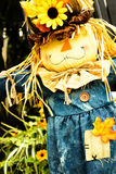Scarecrows with flowers and hay Stock Images