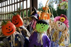 Halloween Scarecrows. Scarecrows of friendly Frankenstein monsters pumpkin heads and witches for Halloween Royalty Free Stock Photo