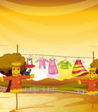 Scarecrows near the hanging clothes Royalty Free Stock Image