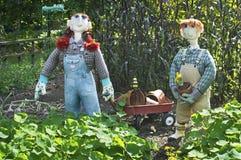 Scarecrows och vagn Arkivbilder