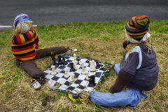 Scarecrows playing chess Stock Photography
