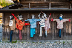 Scarecrows on the wall. Shirakawa-go, Japan - May 2, 2016: Scarecrows on the wall at Historical village of Shirakawa-go. Shirakawa-go is one of Japan's UNESCO Stock Images