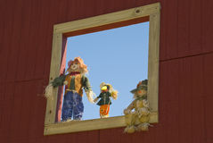 Scarecrows in a Window Royalty Free Stock Image