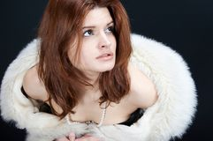 Scared. Girl with fur coat and pearls stock photos
