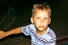 Scared. A young boy looking afraid at the camera Royalty Free Stock Photo