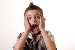 Scared. Six year old boyholding his head yelling stock photos