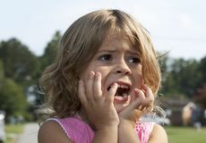 Scared. A picture of a cute little girl scared stock photo