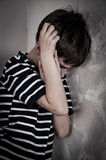 Scared and abused young boy Stock Photography