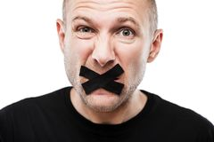 Scared adult man adhesive tape closed mouth Stock Image