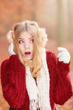 Scared afraid pretty woman in earmuffs. Royalty Free Stock Photography