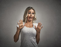 Scared afraid young woman fear. Scared afraid young woman portrait over gray wall background Stock Images