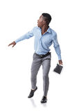 Scared African-American businessman runs. And looks around. isolated on white background. pressure on business Royalty Free Stock Photography