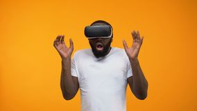 Scared African-American man using virtual reality headset, simulation, close-up. Stock footage stock footage