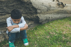 Scared and alone, young Asian child who is at high risk of being bullied, trafficked and abused, selective focus Royalty Free Stock Photos