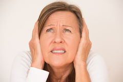 Scared anxious woman covering ears Royalty Free Stock Images