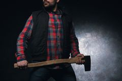 Scared axeman. Armed man with axe stock images