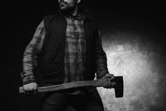 Scared axeman. Armed man with axe royalty free stock photography