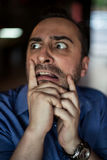 Scared bearded man screaming with frustration Stock Images