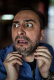 Scared bearded man screaming with frustration Stock Photo